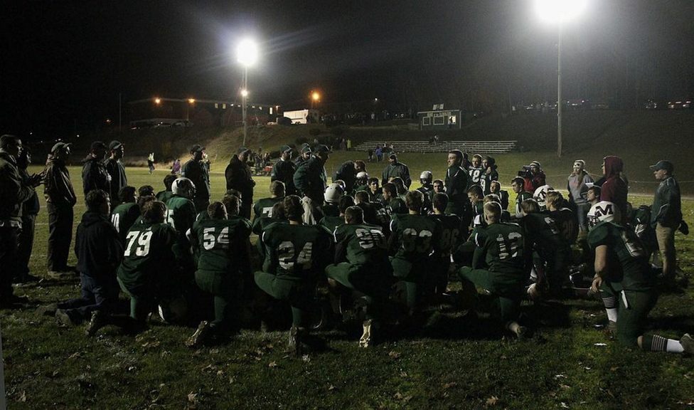 TWO COMMUNITIES, TOGETHER: The Winthrop/Monmouth football team huddles in the end zone after their playoff loss to Dirigo earlier this month. Players from two towns came together to form the new team, which finish the season 9-1.