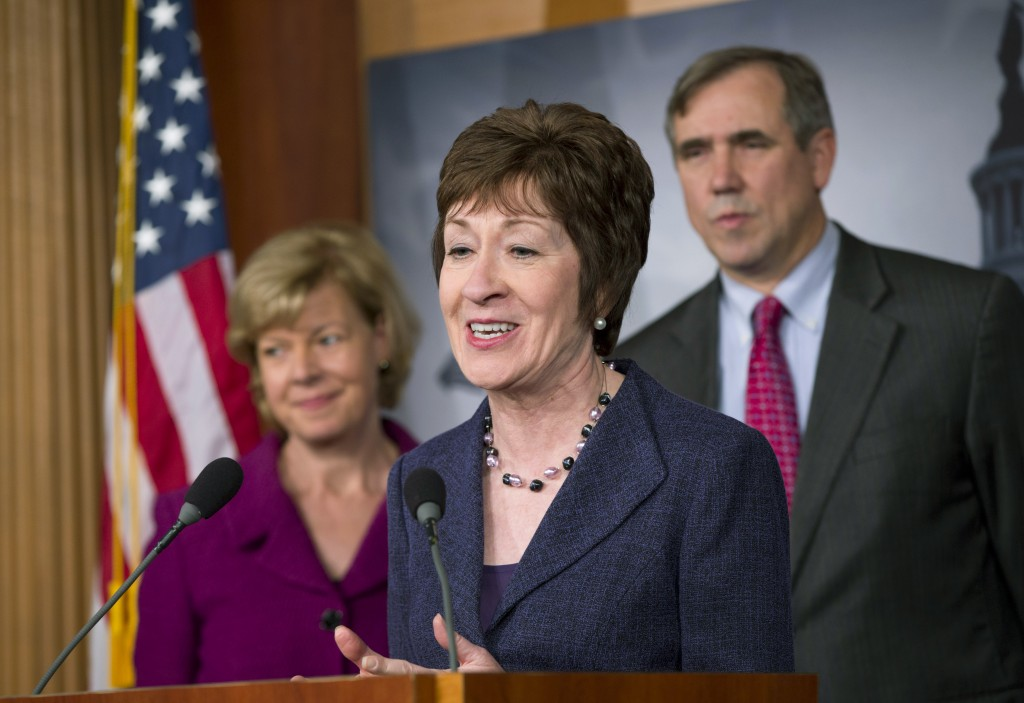 Proponent Sen. Susan Collins, R-Maine, flanked by Sen. Tammy Baldwin, D-Wis., left, and Sen. Jeff Merkley, D-Ore., talks to reporters after the Senate cleared a major hurdle and agreed to proceed to debate on a bill that would prohibit workplace discrimination against gay, bisexual and transgender Americans, at the Capitol in Washington on Monday.