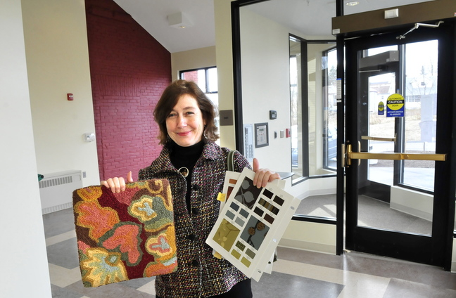 NEW LOOK: Interior designer Lori Larochelle stands in the new entrance to the Gerald Hotel in Fairfield holding examples of carpet and fabric that will be used in the entry.