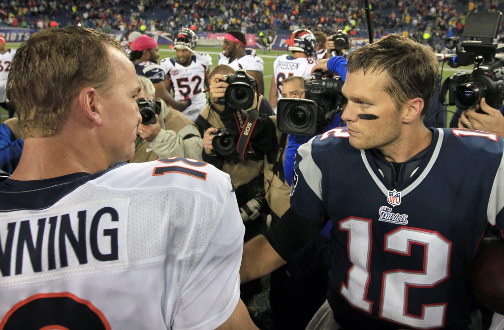 AT IT AGAIN: Denver Broncos quaterback Peyton Manning, left, and New England Patriots quarterback Tom Brady will face off for the 14th time in their careers Sunday night in Foxborough, Mass.