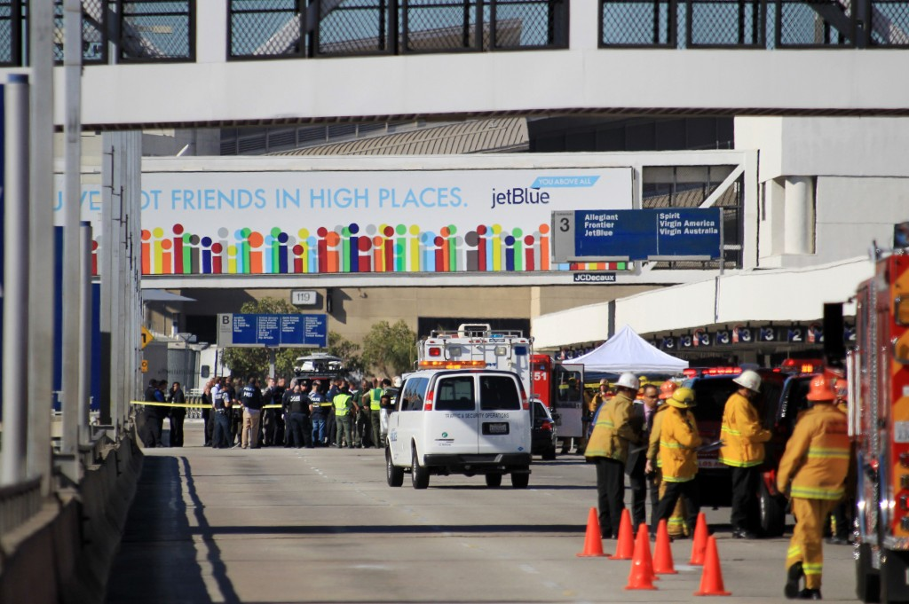 Fire, rescue and police personnel gather at the Los Angeles International Airport on Friday after shots were fired at Terminal 3.