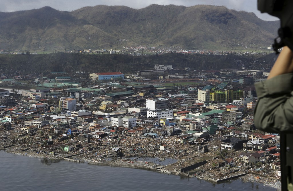 The devastation caused by Typhoon Haiyan, are seen Sunday, Nov. 10, 2013, in Tacloban city, Leyte province in central Philippines. Typhoon Haiyan, one of the most powerful storms on record, slammed into six central Philippine islands on Friday, leaving a wide swath of destruction and scores of people dead.