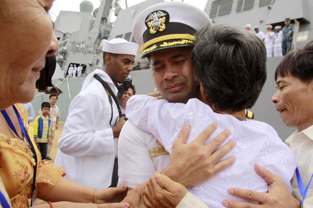 U.S. Navy commander Michael Vannak Khem Misiewicz emotionally embraces his aunt in 2010 in his native Cambodia, where he had been rescued as a child from the violence of the Khmer Rouge and adopted by an American. Now he's accused of passing confidential information on Navy ship routes to a Singapore-based company in order to help facilitate a multimillion-dollar fraud scheme.