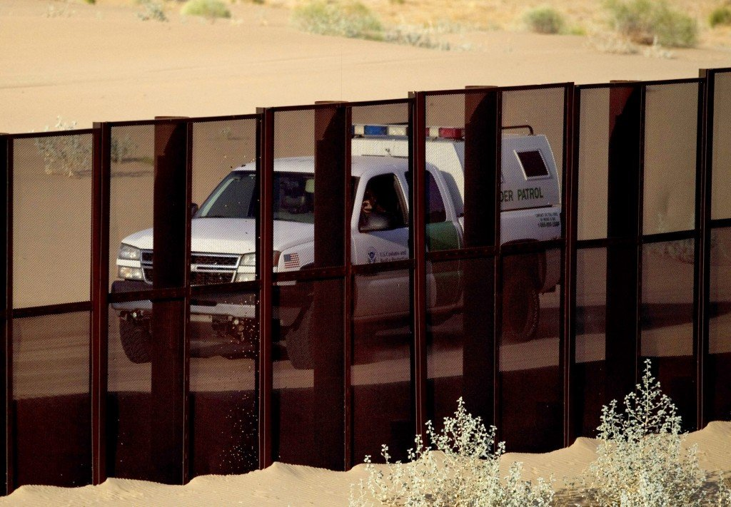 In this July 28, 2010, photo, a U.S. border patrol vehicle drives along the U.S.-Mexico border fence near Yuma, Ariz., as seen from the outskirts of San Luis Rio Colorado, Mexico.