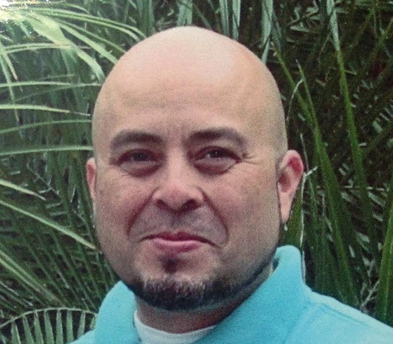 This June 2013 photo released by the Hernandez family shows Transportation Security Administration officer Gerardo Hernandez. Hernandez, 39, was shot to death by a gunman who went on a shooting rampage at Los Angeles International Airport, Nov. 1, 2013.