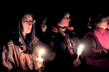FRIEND: Sherissa McLaughlin, left, of Moscow and her mother Sherry, center, attended a candlelight vigil for her friend Jillian Jones in Bingham on Sunday. Jones, who was killed last week in Augusta, grew up in the area. McLaughlin described Jones as a likeable and fun person.