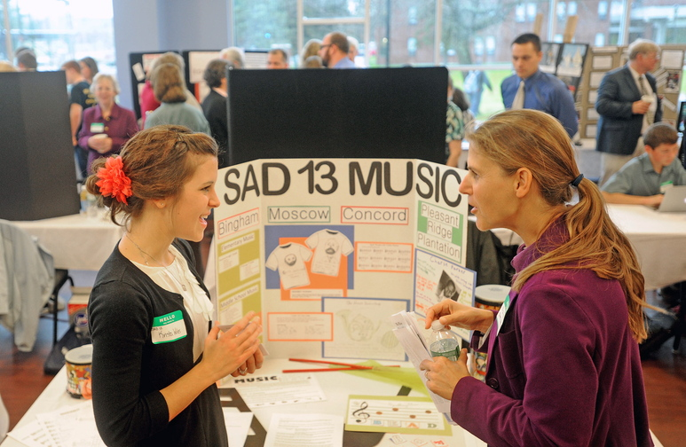 education gathering: Krista Wilser, left, a music teacher with Bingham-based School Administration District 13, speaks with Nichi Farnham, with the State Board of Education during a Kennebec Valley area high school expo at Thomas College on Friday morning.