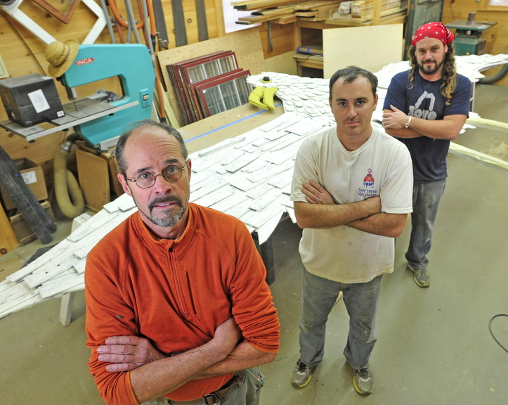restoration crew: Stephen Dionne, left, with his employees Joe Almand, 33, center, and Dylan Daigle, 28, stand next to the 25-foot wooden seagull sculpture created by Skowhegan artist Bernard Langlais that they have restored.