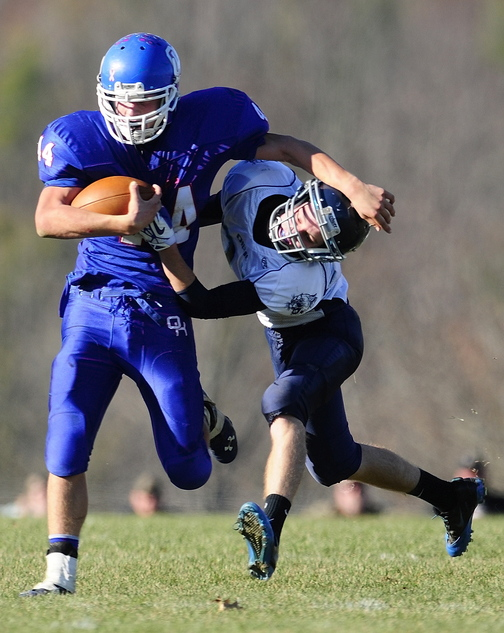 RUNNING TOWARD GOLD: Kyle Flaherty, left, and the Oak Hill High School football team will play Bucksport for the Class D state championship at 2:36 p.m. Saturday at Fitzpatrick Stadium in Portland.
