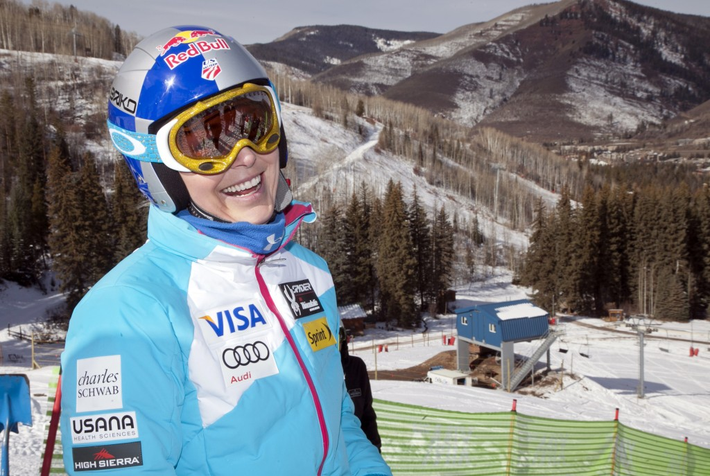 Olympic downhill champion Lindsey Vonn of Colorado prepares for a promotional event at Gold Peak in Vail Colo., on Friday. Vonn, still trying to get her surgically repaired right knee in top shape with the Sochi Olympics approaching, will begin her World Cup season in a few weeks.