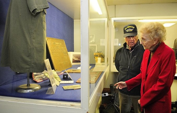 Reunion: Michael Tatosian, of Lewiston, talks to Gertrude Moinester as they look at a display during a tour of the Maine Military Historical Society Museum recently in Augusta. Tatosian and Moinester's late son served in the Navy together in Vietnam.