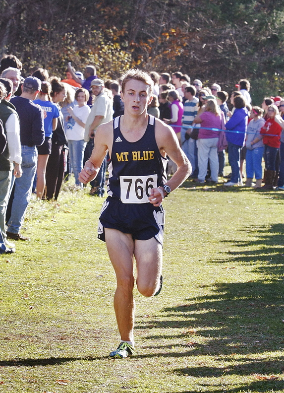 OUT FRONT: Mt. Blue High School's Josh Horne runs alone during the Class A boys cross country state championship meet Saturday at Twin Brooks Recreation Area in Cumberland.