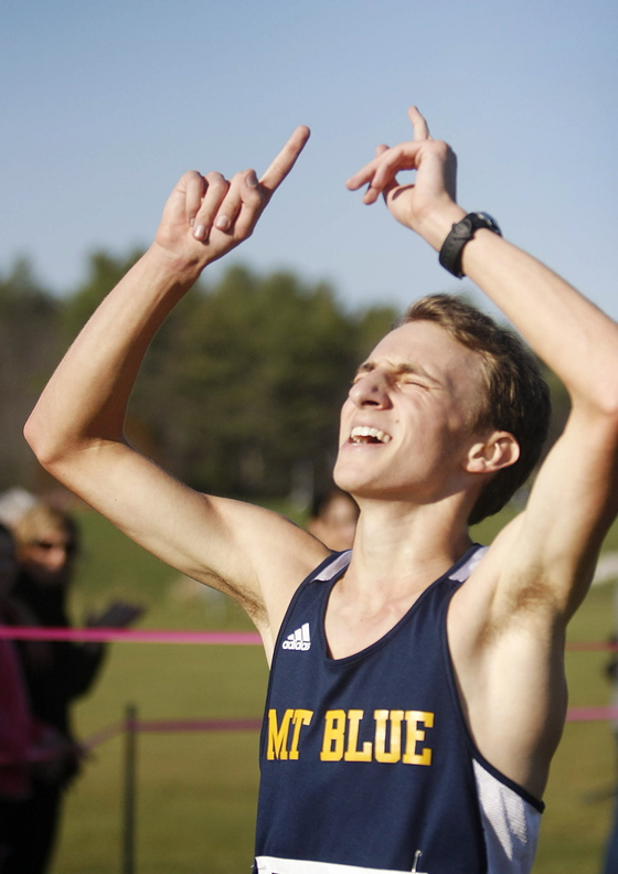 BIG DAY: Mt. Blue High School's Josh Horne celebrates after winning the Class A cross country state championship on Saturday at Twin Brooks Recreation Area in Cumberland.