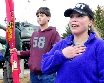 CONTINUED SUPPORT: U.S. Army veteran Emily Childs of China speaks on why she turned out for Veterans Day in Waterville on Monday, Nov. 11, 2013. At left is her son Scott.