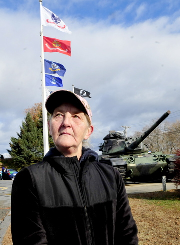 Honoring: Sandra Ouellette of Sidney expresses why she supports and walked in a Veterans Day march on Monday, nov. 11, 2013.