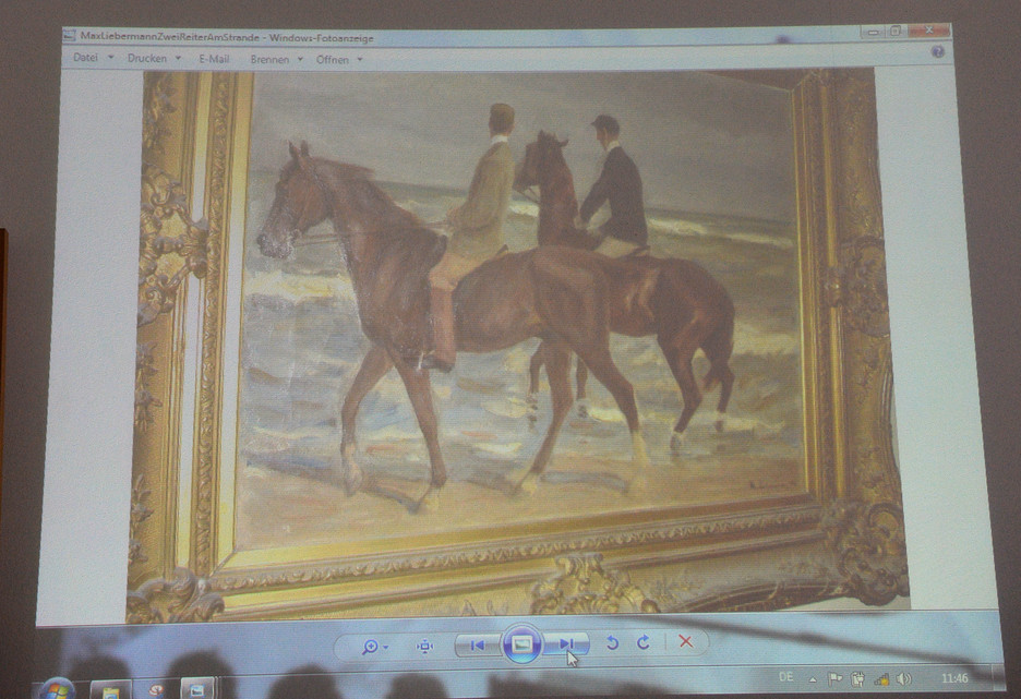 """A painting by Max Liebermann """"Zwei Reiter am Strande"""" (""""Two riders on the beach"""") is projected on a screen during a news conference in Augsburg, Germany, Tuesday."""
