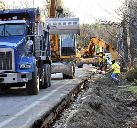 WORK IN PROGRESS: Subcontractors bury recently installed natural gas pipeline along the Middle Road in Fairfield on Tuesday.