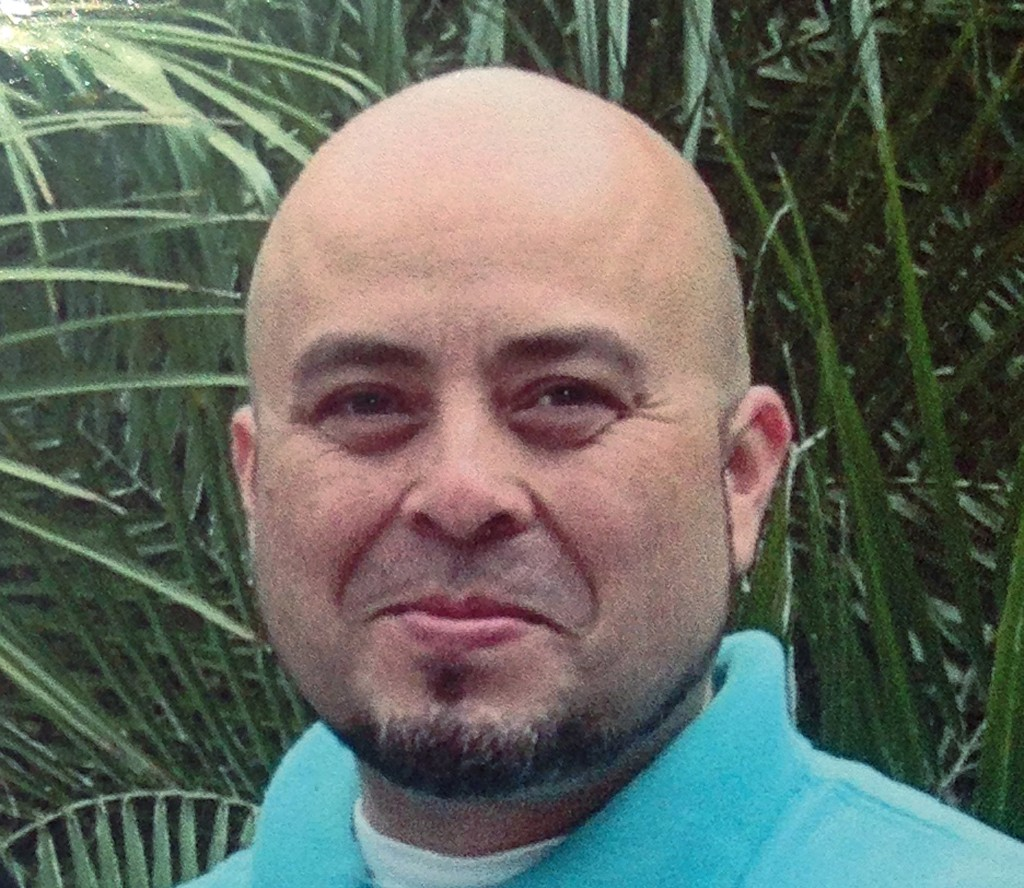 This June, 2013 photo released by the Hernandez family Saturday, Nov. 2, 2013, shows Transportation Security Administration officer Gerardo Hernandez. Hernandez, 39, was shot to death and several others wounded by a gunman who went on a shooting rampage in Terminal 3 at Los Angeles International Airport Friday