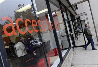 A man leaves Access Health CT, Connecticut's health insurance exchange's first insurance store, on Thursday in New Britain, Conn. The site, which people can visit to sign up for coverage, is the first in the nation.