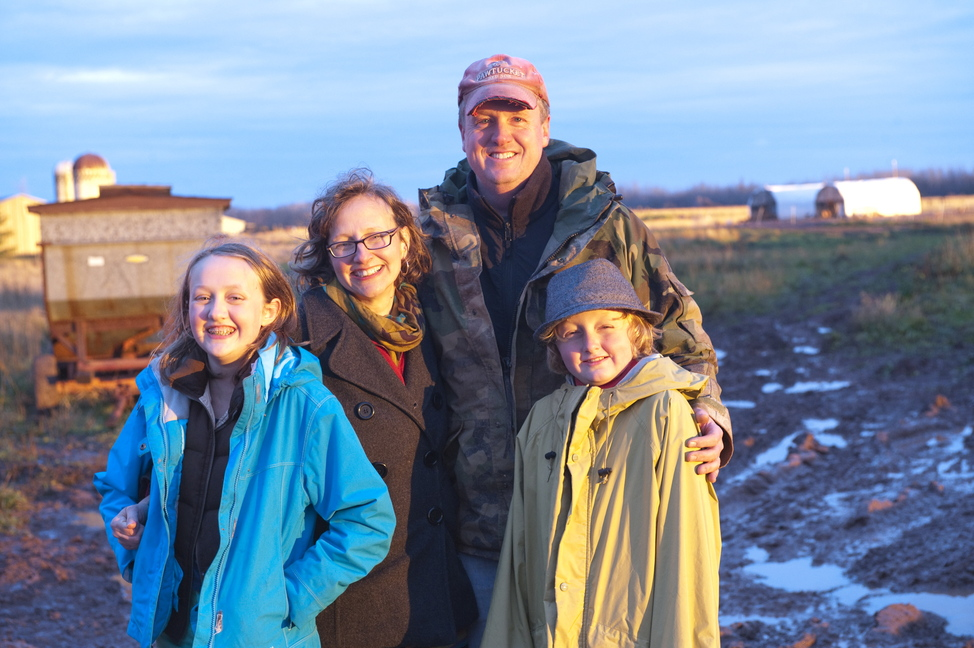 SUPER BOWL SHOT. Former Winslow resident Lucie Amundsen and her husband Jason pose with their children, Milo, 10, and Abbie, 12 at their egg farm in Wrenshall, Minn. The Amundsen's company, Locally Laid, is one of four finalists in a contest to win a television commercial that will be aired during the Super Bowl in February.