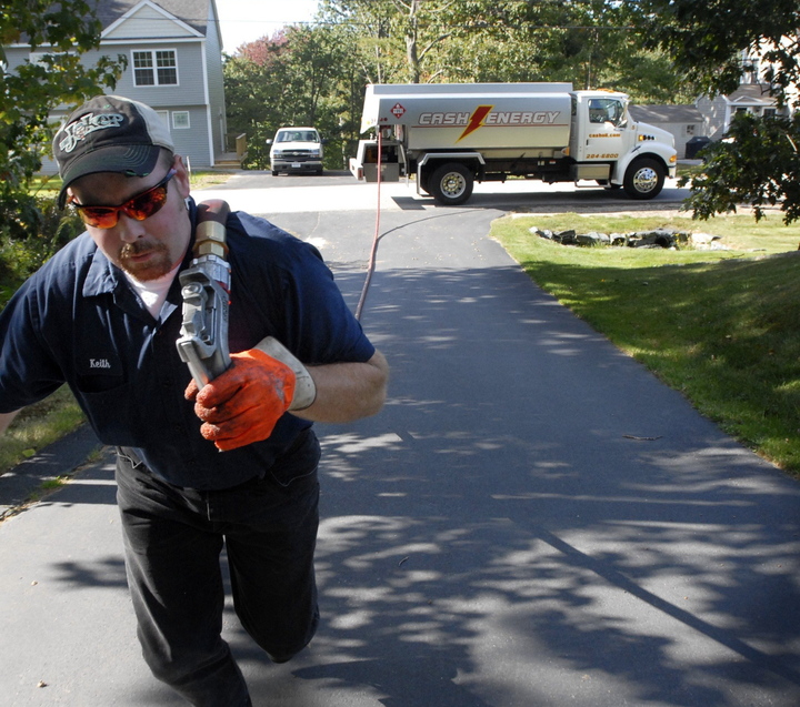 Keith Franklin of Cash Energy delivers heating oil recently to a home in Old Orchard Beach. The state is still waiting for word on what kind of federal fuel assistance Mainers can expect for the coming winter.