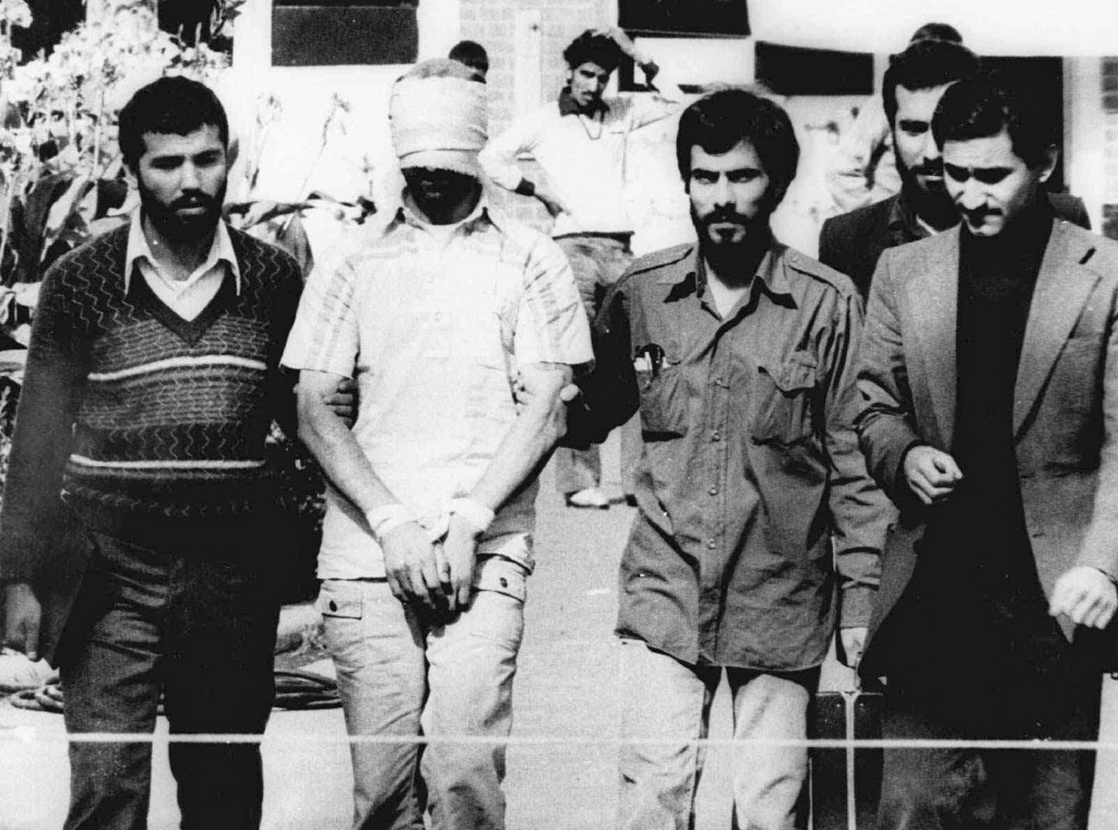 In this Nov. 9, 1979, photo, one of the hostages being held at the U.S. Embassy in Tehran is displayed to the crowd, blindfolded and with his hands bound, outside the embassy.