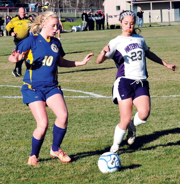 FIRST GOAL: Waterville's Pilar Elias, right, passes the ball as Hermon's Sierra Snow puts on pressures during Waterville's 2-1 win in the Eastern B regional final Wednesday in Waterville.
