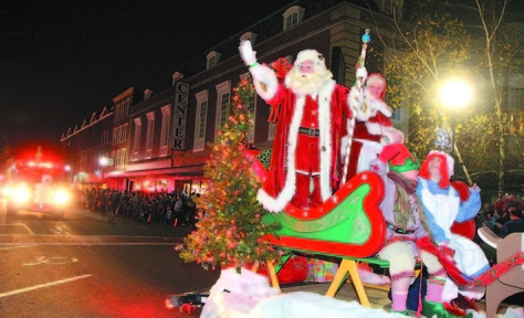 File photo by Jeff Pouland HERE COMES SANTA CLAUS: Santa and Mrs. Claus arrive in downtown Waterville during the 7th Annual Parade of Lights last year.
