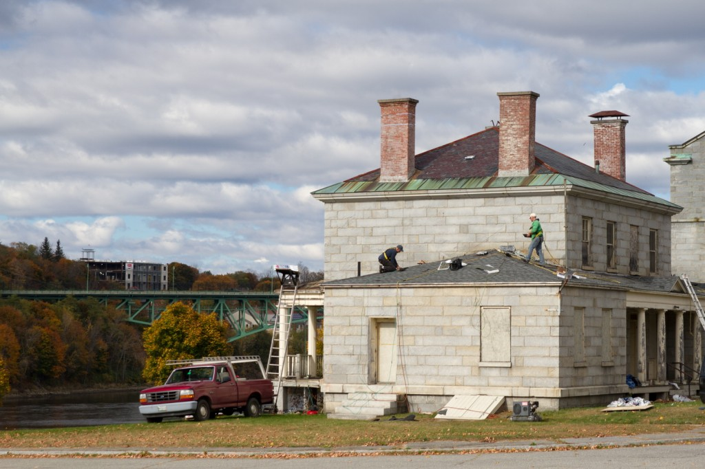 High Maintenance: Workers replace the roof on the South Burleigh building at the Kennebec Arsenal.