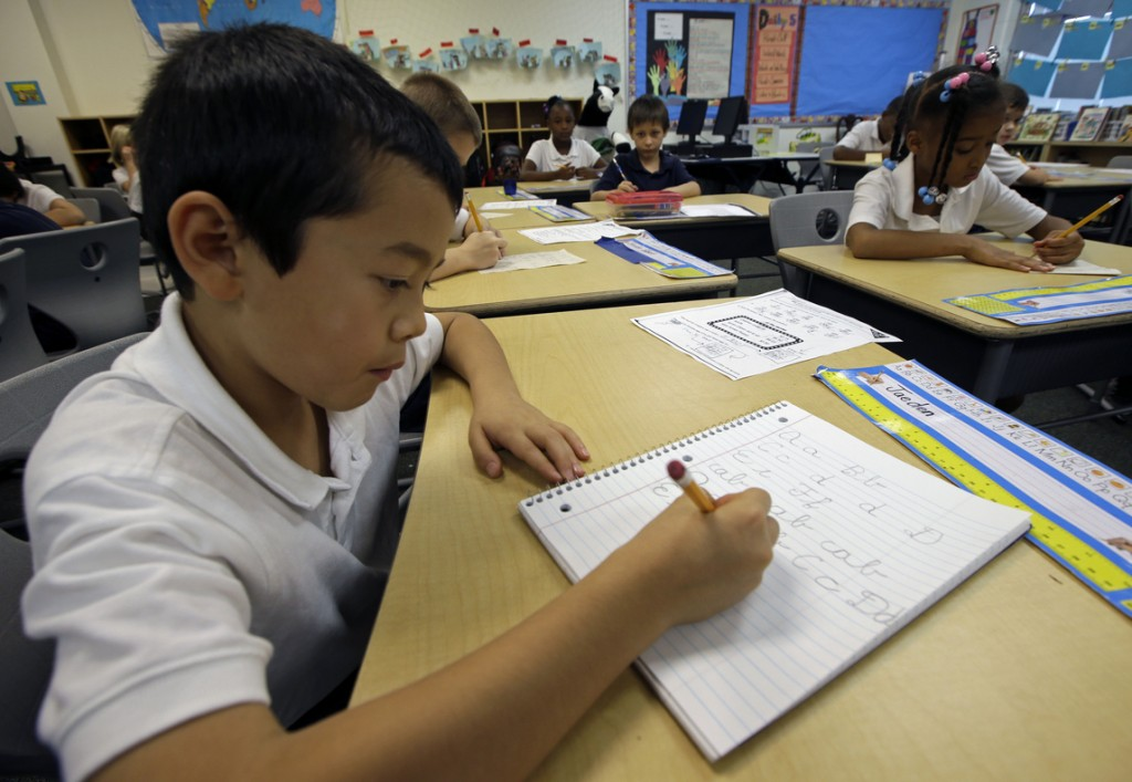 Jaeden Alvarez practices cursive writing at Cleveland K-6 School in Dayton, Ohio, recently.