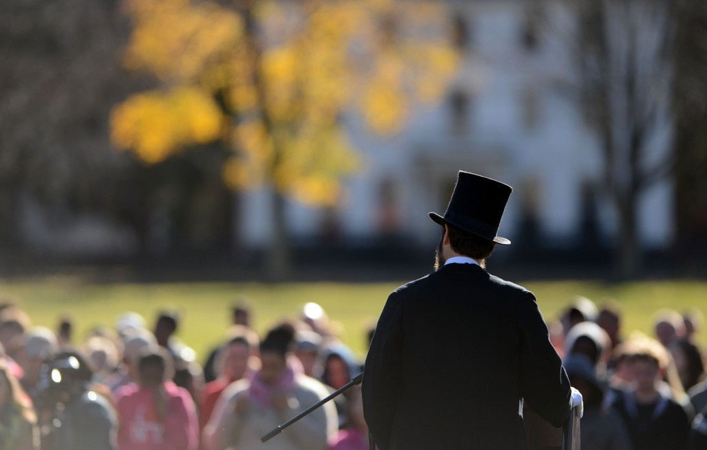 Abraham Lincoln re-enactor Howard Wright recites the Gettysburg Address to students from Norwich Free Academy gathered on Chelsea Parade in Norwich, Conn., to mark the 150th anniversary of the speech Tuesday, Nov. 19, 2013.