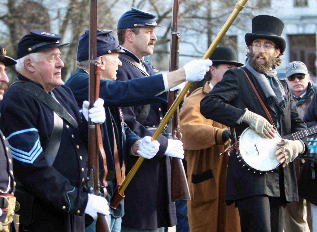 Marek Bennett sings the Battle Cry of Freedom before the Sons of Union Veterans of the Civil War look at the sundial dedication ceremony at the statehouse plaza, Tuesday, Nov. 19, 2013 in Concord, N.H. The original sundial from the Grand Army of the Republic was dedicated in New Hampshire in 1942, but it became lost. The sundial ceremony was held on the 150th anniversary of the dedication of the Gettysburg National Cemetery by Abraham Lincoln.