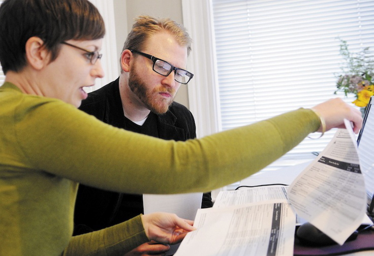 In this Oct. 1, 2013 file photo, Emily Brostek, left, assists Jesse Miller of Portland in learning about health insurance options under the Affordable Care Act. Maine insurance regulators will allow Anthem Blue Cross and Blue Shield to renew policies that were slated for cancellation next year because the plans did not meet the minimum standards of President Obama's new health care law.