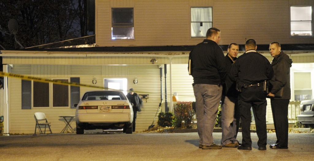 Augusta and State Police Detectives confer Wednesday evening outside of an apartment at 32 Crosby Street in Augusta after a deceased woman was discovered inside the first floor unit just after 8 p.m. A man also inside the apartment was transported to the hospital with injuries, police said. State Police detectives from the Major Crimes Unit took charge of the investigation that authorities characterized as a suspicious death. Chief Medical Examiner Dr. Margaret Greenwald arrived at midnight to determine a cause of death, according to authorities.