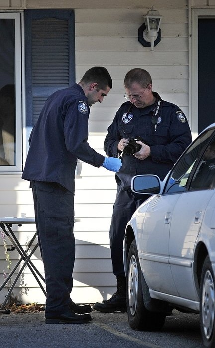 Investigators continue to work at the scene of a suspicious death on Thursday at 32 Crosby St. in Augusta