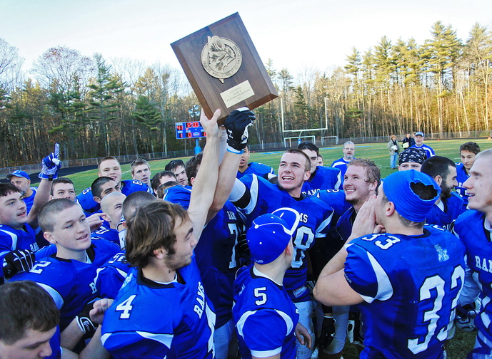Kennebunk #88, Austin Sandler, center, and his teammates hold up their trophy while celebrating their win over Marshwood in the Western Class B regional final at Kennebunk High School Saturday, Nov. 16, 2013. Jill Brady/Staff Photographer.