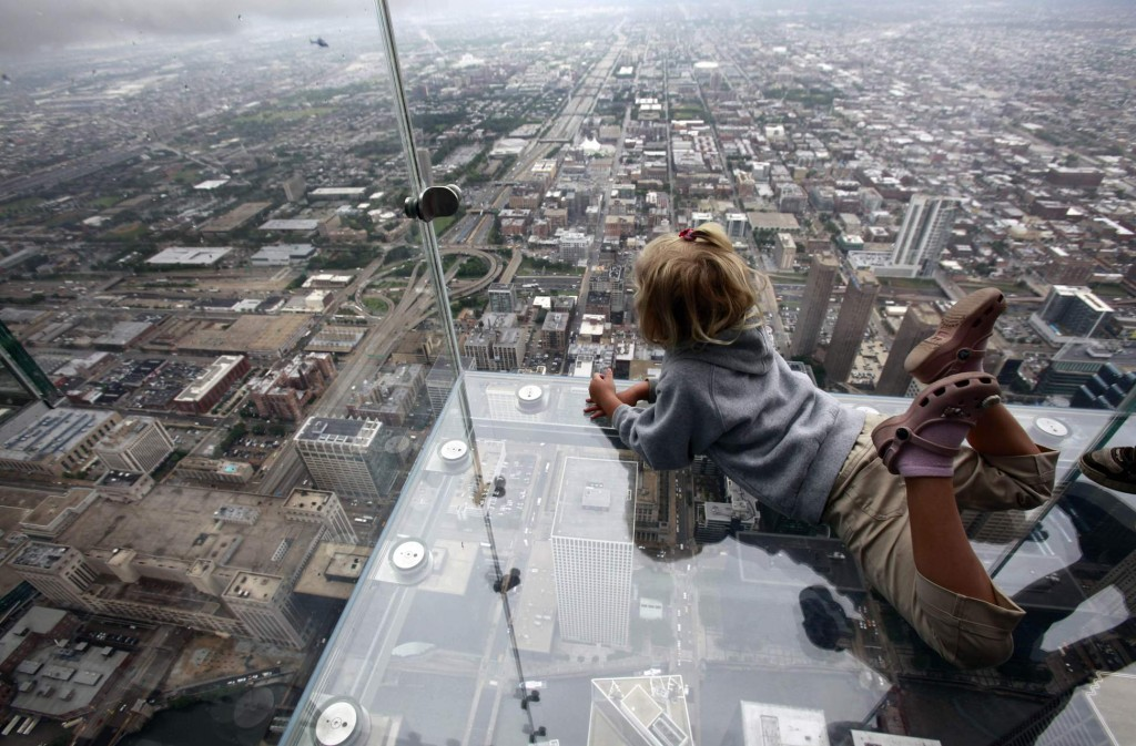 """The view of Chicago from """"The Ledge,"""" at the 110 story, 1,450 foot Willis Tower. The glass balcony is suspended 1,353 feet in the air and juts out 4 feet from the Sears Tower's 103rd floor Skydeck. Associated Press"""