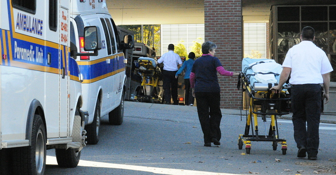 Staff photo by Joe Phelan On the Move: Paramedics and transport nurses roll empty stretchers into the former Augusta MaineGeneral hospital as they work to move patients from there to the new Alfond Center for Health early in the morning on Saturday in Augusta.