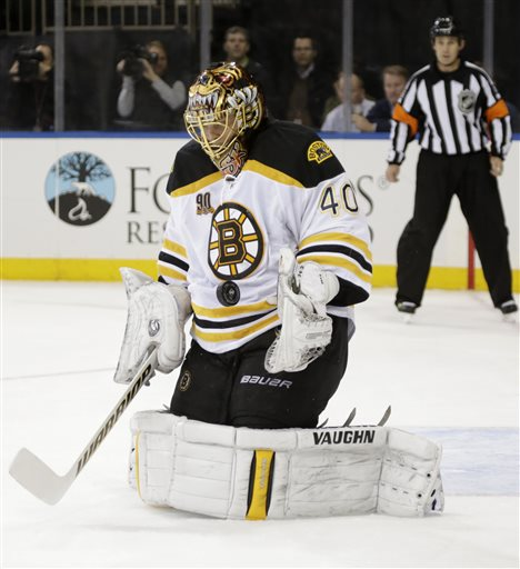 Boston Bruins goalie Tuukka Rask (40) blocks a shot in the second period of their NHL hockey game against the New York Rangers at Madison Square Garden in New York, Tuesday, Nov. 19, 2013. (AP Photo/Kathy Willens)
