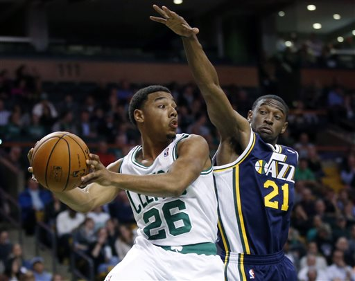 Boston Celtics guard Phil Pressey (26) looks to pass against Utah Jazz guard Ian Clark (21) during the second half of an NBA basketball game in Boston on Wednesday, Nov. 6, 2013. The Celtics won 97-87. (AP Photo/Elise Amendola) TD Garden
