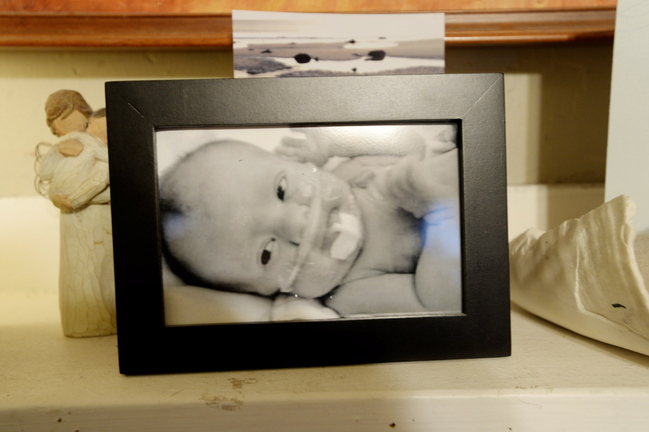 A photograph of Charlie sits on the mantel of the family's home in South Portland.