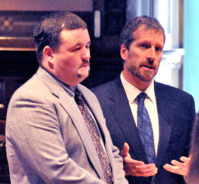 Gun mishap: Adam J. Keene, left, listens as his attorney, Philip Mohlar, speaks during Keene's sentencing Tuesday in Kennebec County Superior Court in Augusta.