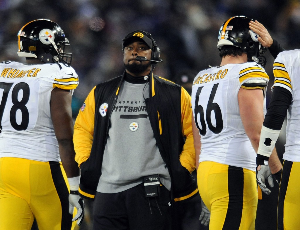 "FILE - In this Nov. 28, 2013 file photo, Pittsburgh Steelers coach Mike Tomlin stands on the sideline during an official play review in the second half of an NFL football game against the Baltimore Ravens, in Baltimore. Tomlin has been fined $100,000 for interfering with a play against the Baltimore Ravens on Thanksgiving. The NFL also said Wednesday, Dev. 4, 2013, that it would consider docking Pittsburgh a draft pick ""because the conduct affected a play on the field."""
