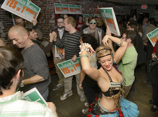 "Belly dancer Whitley ""Nabintu"" Marshall dances as proponents of Portland's Yes on One celebrate at Brian Boru in Portland on Nov. 5. Police, city officials and proponents of legalization want to clarify the ordinance."