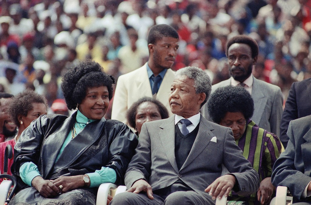 In this Feb. 13, 1990 file photo, Nelson Mandela, right, with his wife, Winnie, participate in a South African Communist Party Rally in the fully-packed Soccer City stadium in Soweto, South Africa, shortly after his release from 27 years in prison. South Africa's President Jacob Zuma said, Thursday, Dec. 5, 2013, that Nelson Mandela has died. He was 95.