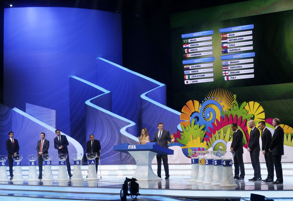 Groups A to D are displayed on a video screen during the draw ceremony for the 2014 soccer World Cup in Costa do Sauipe near Salvador, Brazil, Friday, Dec. 6, 2013.