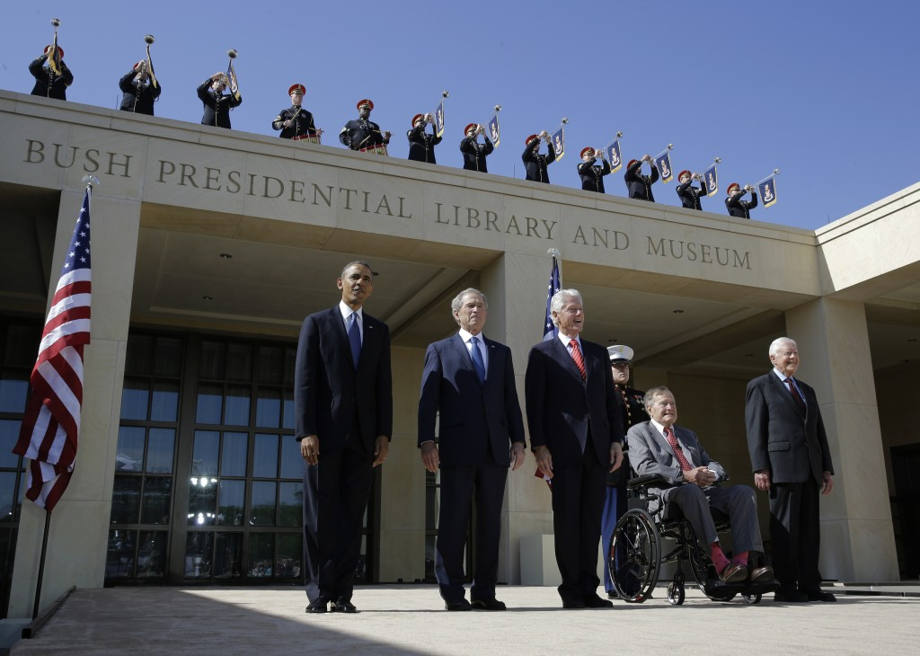 In this April 2013 file photo, from left, President Barack Obama, former president George W. Bush, former president William J. Clinton, former President George H.W. Bush and former president Jimmy Carter arrive for the dedication of the George W. Bush Presidential Center Thursday, April 25, 2013, in Dallas. Presidents Obama and Clinton, and George W, Bush, will travel to South Africa to attend memorial services for Nelson Mandela.