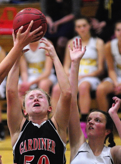 BATTLE FOR THE BOARD: Gardiner's Camden Cone, left, and Maranacook's Elizabeth D'Angelo battle for rebound during the first game of the season Friday at Maranacook Community High School in Readfield.
