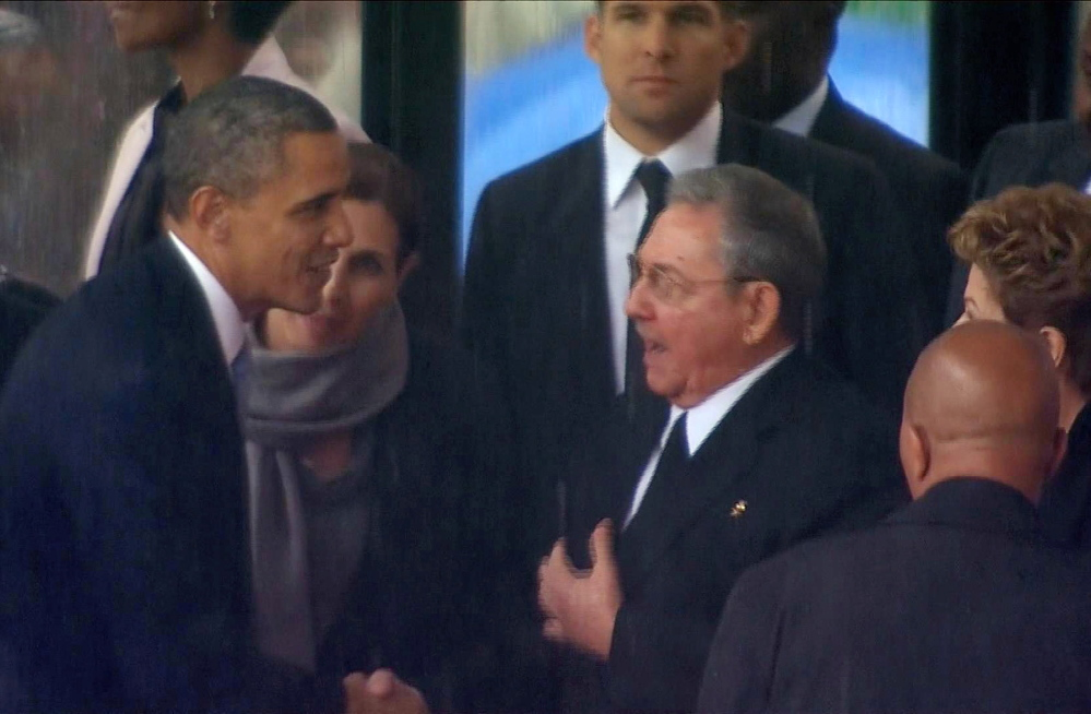 In this image from TV, President Barack Obama shakes hands with Cuban President Raul Castro at the FNB Stadium in Soweto, South Africa, Tuesday. The handshake between the leaders of the two Cold War enemies came during a ceremony that was focused on Mandela's legacy of reconciliation.