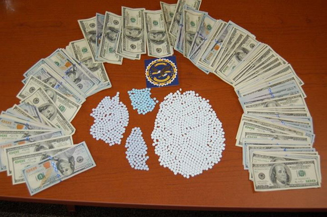 Drugs and cash seized by MDEA agents in several raids in Hancock County on Tuesday.